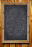Chalkboard on a wood background Royalty Free Stock Images
