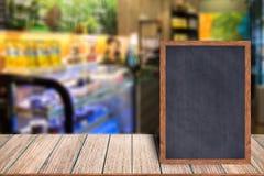 Chalkboard wood frame blackboard sign menu on wooden table. Royalty Free Stock Image
