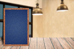 Chalkboard wood frame blackboard sign menu on wooden table, Blurred image background Stock Photo