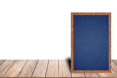 Chalkboard wood frame blackboard sign menu on wooden table is laying on white background with copy space. Royalty Free Stock Photo