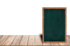 Chalkboard wood frame blackboard sign menu on wooden table is laying on white background with copy space. Chalkboard wood frame blackboard sign menu on wooden Royalty Free Stock Photo