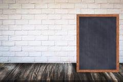 Chalkboard wood frame blackboard sign menu on wooden table Stock Images
