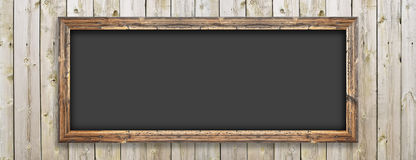 Chalkboard on the wood wall Stock Photography