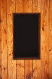 Chalkboard on wooden background Stock Images