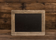 Chalkboard on wooden background. Vintage texture Royalty Free Stock Images