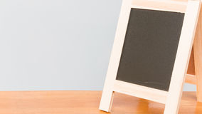Chalkboard on wooden board and gray background Royalty Free Stock Image