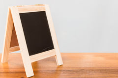 Chalkboard on wooden board and gray background Stock Photo