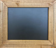 A chalkboard with wooden frame Royalty Free Stock Image