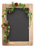 Chalkboard with wooden frame and christmas decoration stock photography