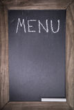 Chalkboard with wooden frame for restaurant with written text menu layout template background. With chalk Stock Photography