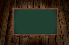 Chalkboard on wooden grunge background Royalty Free Stock Photos