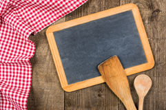 Chalkboard and wooden spoons with a checkered cloth Royalty Free Stock Images
