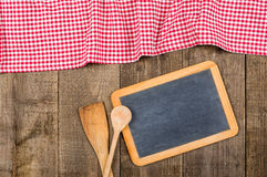 Chalkboard and wooden spoons with a checkered tablecloth Stock Photos