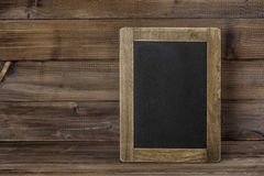 Chalkboard on wooden texture. Rustic vintage background Royalty Free Stock Photo