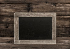 Chalkboard on wooden texture. Vintage background Royalty Free Stock Images