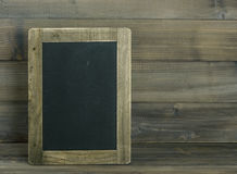 Chalkboard on wooden textured background. Vintage style Royalty Free Stock Photography