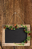 Chalkboard on wooden wall with christmas tree bruch Stock Image