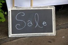 Chalkboard with the word SALE written on face of it Stock Image