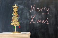 Chalkboard writing - Merry Royalty Free Stock Image