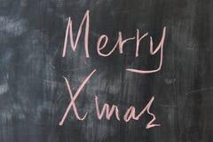 Chalkboard writing - Merry Royalty Free Stock Photos