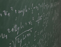 Chalkboard with written science. A chalkboard (blackboard) with formulae and equations written with chalk. Great for use in black and white royalty free stock images
