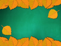 Chalkboard with yellow leaves Stock Images