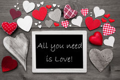 Chalkbord With Many Red Hearts, All You Need Is Love. Chalkboard With English Text All You Need Is Love. Many Red Textile Hearts. Grey Wooden Background With Royalty Free Stock Photo