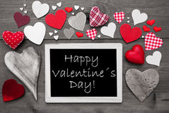 Chalkbord noir et blanc, coeurs rouges, jour de valentines heureux Photo stock