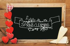 Chalkbord, Red And Yellow Hearts, Calligraphy Spring Cleaning stock images