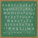 Chalked alfabet på en svart tavlabakgrund Royaltyfri Bild