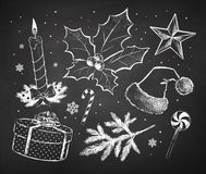 Chalked Christmas sketches collection. Drawn on black chalkboard background Stock Photo