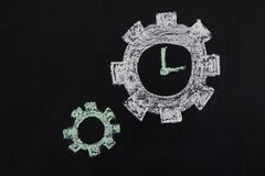 Chalked gears and clock on chalkboard Royalty Free Stock Photos