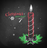 Chalked red Christmas candle. Royalty Free Stock Image