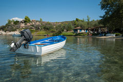 Chalkidiki, boat moored in front of a private beach Stock Image