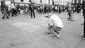 Chalking on the pavements in Trafalgar Square London Royalty Free Stock Photos