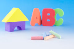 Chalks and ABC letters. Colourful chalks and ABC on the background Royalty Free Stock Photography