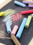 Chalks and black chalkboard Royalty Free Stock Images