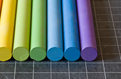 Chalks on chalkbord Stock Image