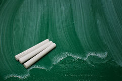 Chalks on green chalkboard Royalty Free Stock Photo