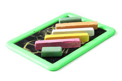 Chalks with scribbles on chalkboard. Colorful chalks with scribbles on chalkboard Stock Photo