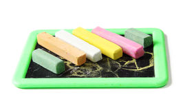 Chalks with scribbles on chalkboard. Royalty Free Stock Photography