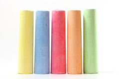 Chalks in a variety of colors. On white background stock images