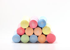 Chalks in a variety of colors. On white background royalty free stock image