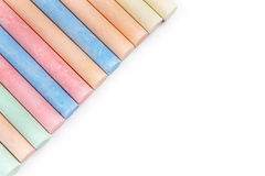 Chalks in a variety of colors arranged on a white background stock photos