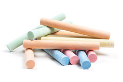 Chalks in a variety of colors arranged on a white background royalty free stock image