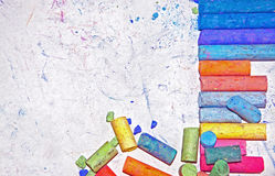 Chalky Arrangement. Image of colored drawing chalk arranged on white paper Stock Photos