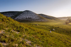 Chalky Mount. Spring landscape, the traveler at dawn among the purple mountains Stock Images
