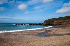 Challaborough Bay beach. The gorgeous blue sea laps the perfect challaborough bay beach Stock Photo