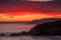 Challaborough Bay sunset. Fire skies over Challaborough Bay in Devon ,England Royalty Free Stock Image