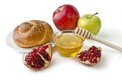 Challah, apples, pomegranate and bowl of honey Stock Photo